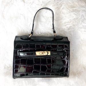 Black patent faux crocodile buckle mini handbag